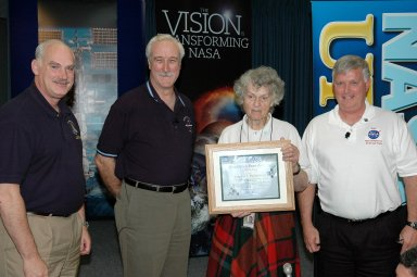 KENNEDY SPACE CENTER, FLA. - After the NASA Update by Administrator Sean O?Keefe, Center Director Jim Kennedy presented a One NASA Peer Award to Virginia Whitehead for her outstanding customer service. From left are Associate Administrator of Space Operations Mission Directorate William F. Readdy, O'Keefe, Whitehead, and Kennedy. Whitehead is a manager in the Center?s Payload Processing Directorate. The award is given to recognize employees who have demonstrated behaviors consistent with the spirit of One NASA and are called Peer Awards because candidates must be nominated by their peers.