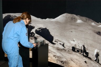 KENNEDY SPACE CENTER, FLA. - At the Museum of Science and Industry (MOSI) in Tampa, a student from one of NASA?s Explorer Schools, Stewart Middle School in Tampa, tries her hand at an interactive exhibit. The students are at MOSI to view the space exhibit Space: A Journey to Our Future, an extraordinary, interactive exhibition designed to entertain, educate and inspire. Another exhibit is SPACE STATION, the first cinematic journey to the International Space Station (ISS), where audiences can experience for themselves life in zero gravity aboard the new station.