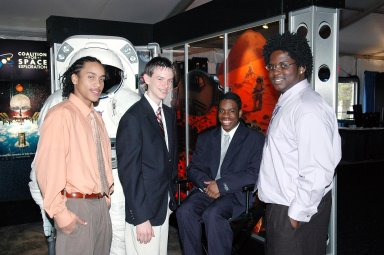 KENNEDY SPACE CENTER, FLA. - At the ?1st Space Exploration Conference: Continuing the Voyage of Discovery,? held at Disney?s Contemporary Resort in Orlando, the winners of the Space Exploration Video Festival award sponsored by Lockheed Martin get together. Second from left is Daniel Stearns, from East Longmeadow, Mass. The others are the winning team from NASA Explorer School McNair High School in Dekalb County, Ga. At left is Theo Maxie; at right are Daniel Jackson and Trenten Nash. The three-day conference drew attendees from around the world. It presented topics on new missions, technologies and infrastructure needed to turn the vision for space exploration into reality. Keynote speakers at the three-day conference include NASA Administrator Sean O'Keefe, Congressman Dave Weldon, film director James Cameron and NASA?s senior Mars scientist James Garvin. The conference has drawn attendees from around the world.