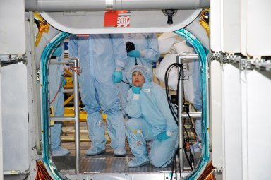 KENNEDY SPACE CENTER, FLA. - Members of the Space Shuttle Discovery?s Return to Flight STS-114 crew are conducting a payload Crew Equipment Interface Test (CEIT) in the Space Station Processing Facility at NASA?s Kennedy Space Center, Fla. Seen here in the Multi-Purpose Logistics Module Raffaello is Mission Specialist Wendy Lawrence. The launch window for STS-114 is May 15 to June 3, 2005. During CEIT, the crew is inspecting the resupply stowage racks installed in the Italian-built Multi-Purpose Logistics Module Raffaello and performing tool and equipment interface checks with the Thermal Protection System (TPS) repair sample box, the Control Moment Gyroscope (CMG) and the External Stowage Platform-2 in preparation for the mission?s three scheduled spacewalks. The seven-member crew will fly to the International Space Station primarily to evaluate procedures for flight safety, including Shuttle inspection and repair techniques. The TPS repair sample box contains tile samples for the Detailed Test Objective (DTO) that will enable the crew to test new on-orbit TPS repair techniques. The CMG installed on the Lightweight Multi-Purpose Experiment Support Structure Carrier (LMC) is a replacement for an inoperable CMG on the International Space Station. The CMGs provide altitude control for the outpost keeping it properly oriented toward the Sun without use of rocket fuel. The ESP2 will carry replacement parts, known as orbital replacement units (ORU) to the Station. The platform will be deployed and attached to the Station?s airlock and will be used as a permanent spare parts facility.