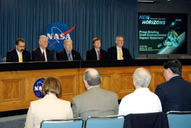 KENNEDY SPACE CENTER, FLA. - Representatives of NASA?s New Horizons Mission to Pluto discuss the mission during a press briefing on the Draft environmental Impact Statement at NASA?s Kennedy Space Center. From left are Orlando Figueroa, deputy association administrator for Programs, Science Mission Directorate; Earl Wahlquist, associate director for Space and Defense Power Systems, Department of Energy, in Germantown, Md.; Kurt Lindstrom, New Horizons Program executive, with NASA; Hal Weaver, New Horizons Project scientist, Johns Hopkins University Applied Physics Laboratory in Laurel, Md.; and Glen Fountain, New Horizons Project manager, also with Johns Hopkins University Applied Physics Laboratory. The spacecraft will explore Pluto, its moon Charon, and possibly one or more objects within the Kuiper Belt. New Horizons is planned for launch during a window from Jan. 11 to Feb. 14, 2006, on an Atlas V 551 booster with a Star 48B third stage. It will proceed to a Jupiter gravity assist between Feb. 25 and March 2, 2007, if launched during the first 23 days of the launch window. (If it is launched during the last 12 days of the launch window it will have a direct-to-Pluto trajectory. There is a backup launch opportunity in February 2007.)