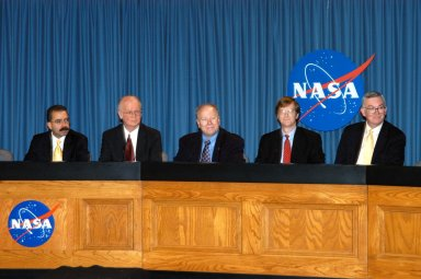 KENNEDY SPACE CENTER, FLA. - Representatives of NASA?s New Horizons Mission to Pluto are ready to answer questions during a press briefing on the Draft environmental Impact Statement at NASA?s Kennedy Space Center. From left are Orlando Figueroa, deputy association administrator for Programs, Science Mission Directorate; Earl Wahlquist, associate director for Space and Defense Power Systems, Department of Energy, in Germantown, Md.; Kurt Lindstrom, New Horizons Program executive, with NASA; Hal Weaver, New Horizons Project scientist, Johns Hopkins University Applied Physics Laboratory in Laurel, Md.; and Glen Fountain, New Horizons Project manager, also with Johns Hopkins University Applied Physics Laboratory. The spacecraft will explore Pluto, its moon Charon, and possibly one or more objects within the Kuiper Belt. New Horizons is planned for launch during a window from Jan. 11 to Feb. 14, 2006, on an Atlas V 551 booster with a Star 48B third stage. It will proceed to a Jupiter gravity assist between Feb. 25 and March 2, 2007, if launched during the first 23 days of the launch window. (If it is launched during the last 12 days of the launch window it will have a direct-to-Pluto trajectory. There is a backup launch opportunity in February 2007.)