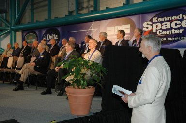 KENNEDY SPACE CENTER, FLA. - Owen Garriott, chairman of the Astronaut Hall of Fame, waits to address guests at the Astronaut Hall of Fame Induction Ceremony held at the Kennedy Space Center Visitor Complex?s Apollo/Saturn V Center. Hall of Famers seated on stage are (from left, back row), Dick Gordon, Walt Cunningham, Bill Anders, Ed Mitchell, Al Worden, Charles Duke, Jack Lousma, Bill Pogue, Robert Crippen, Dan Brandenstein, Robert ?Hoot? Gibson and Stephen Covey. In front are (left to right) Jim Lovell, Fred Haise and Vance Brand. The new inductees (not pictured) are Gordon Fullerton, Bruce McCandless and Joe Allen. Recognized for their individual flight accomplishments and contributions to the success and future success of the U.S. space program, this elite group of inductees is among only 60 astronauts to be honored in the Hall of Fame and the fourth group of Space Shuttle astronauts named.
