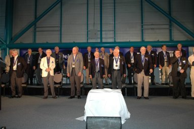 KENNEDY SPACE CENTER, FLA. - Members of the Astronaut Hall of Fame are applauded by the guests at the Astronaut Hall of Fame Induction Ceremony held at the Kennedy Space Center Visitor Complex?s Apollo/Saturn V Center. From left are Al Gordon, John Young, Walt Cunningham, Bill Anders, Owen Garriott, Ed Mitchell, Gordon Fullerton, Al Worden, Charlie Duke, Joe Allen, Jack Lousma, Bruce McCandless, Bill Pogue, Robert Crippen, Jim Lovell, Dan Brandenstein, Robert ?Hoot? Gibson, Fred Haise, and Stephen Covey. Not pictured are Scott Carpenter and Vance Brand. McCandless, Allen and Fullerton are the 2005 inductees. Recognized for their individual flight accomplishments and contributions to the success and future success of the U.S. space program, this elite group of inductees is among only 60 astronauts to be honored in the Hall of Fame and the fourth group of Space Shuttle astronauts named.