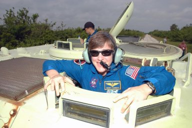 KENNEDY SPACE CENTER, FLA. - During Terminal Countdown Demonstration Test (TCDT) activities at NASA?s Kennedy Space Center, the STS-114 Mission Specialist Wendy Lawrence is getting ready to practice driving an M-113, an armored personnel carrier that is used for speedy departure from the launch pad in an emergency. The TCDT is held at KSC prior to each Space Shuttle flight. It provides the crew of each mission an opportunity to participate in simulated countdown activities. The test ends with a mock launch countdown culminating in a simulated main engine cutoff. The crew also spends time undergoing emergency egress training exercises at the launch pad. STS-114 is the first Return to Flight mission to the International Space Station. The launch window extends July 13 through July 31.