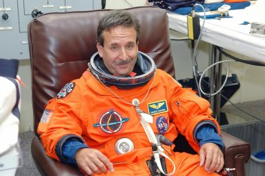 KENNEDY SPACE CENTER, FLA. - As part of pre-pack and fit check for Terminal Countdown Demonstration Test (TCDT) activities, STS-114 Mission Specialist Charles Camarda has his launch suit checked for fit. The TCDT is held at KSC prior to each Space Shuttle flight. It provides the crew of each mission an opportunity to participate in simulated countdown activities. The test ends with a mock launch countdown culminating in a simulated main engine cutoff. The crew also spends time undergoing emergency egress training exercises at the launch pad. STS-114 is the first Return to Flight mission to the International Space Station. The launch window extends July 13 through July 31.
