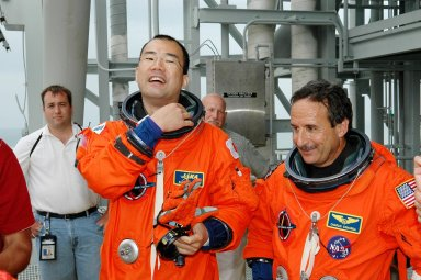 KENNEDY SPACE CENTER, FLA. - Following the mock countdown on Launch Pad 39B, STS-114 Mission Specialists Soichi Noguchi (left) and Charles Camarda wait for their turn in the slidewire basket used for emergency egress from the Fixed Service Structure at the pad. This is part of the pre-launch training included in Terminal Countdown Demonstration Test (TCDT) activities. TCDT provides the crew of each mission an opportunity to participate in various simulated countdown activities, including equipment familiarization and emergency egress training. STS-114 is the first Return to Flight mission to the International Space Station. The launch window extends July 13 through July 31.
