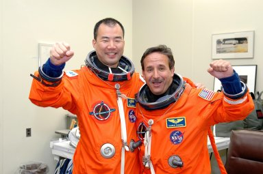 KENNEDY SPACE CENTER, FLA. - STS-114 Mission Specialists Soichi Noguchi (left) and Charles Camarda are suited up in the Operations and Checkout Building and ready for the trip to Launch Pad 39B for a mock launch countdown culminating in a simulated main engine cutoff. Noguchi is with the Japan Aerospace Exploration Agency. The dress rehearsal is part of Terminal Countdown Demonstration Test (TCDT) activities held prior to each Space Shuttle flight. It provides the crew of each mission an opportunity to participate in various simulated countdown activities, including equipment familiarization and emergency egress training. STS-114 is the first Return to Flight mission to the International Space Station. The launch window extends July 13 through July 31.