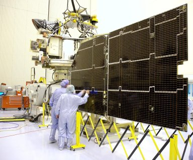 KENNEDY SPACE CENTER, FLA. - In the Payload Hazardous Servicing Facility, technicians inspect the solar panels for the Mars Reconnaissance Orbiter (MRO) during an electromagnetic interference verification test. If no interference is found during the test, the Shallow Radar Antenna (SHARAD) will be installed on the spacecraft. The spacecraft is undergoing multiple mechanical assembly operations and electrical tests to verify its readiness for launch. The MRO was built by Lockheed Martin for NASA?s Jet Propulsion Laboratory in California. It is the next major step in Mars exploration and scheduled for launch from Launch Complex 41 at Cape Canaveral Air Force Station in a window opening Aug. 10. The MRO is an important next step in fulfilling NASA?s vision of space exploration and ultimately sending human explorers to Mars and beyond.
