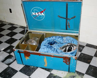 """KENNEDY SPACE CENTER, FLA. - This locker reveals a long-lost spacesuit recently uncovered at the Cape Canaveral Air Force Station (CCAFS) in Florida. A recent venture into a long-locked room at CCAFS uncovered interesting artifacts of a bygone era: retired space suits from Americans who trained in the 1960s to be astronauts aboard an Air Force orbiting reconnaissance laboratory. Two security officers were doing a check of a facility at Launch Complex 5/6 blockhouse. NASA Special Agent Dan E. Oakland and Security Manager Henry Butler, who is with Delaware North Parks and Resorts, the company that oversees the museum, discovered a locked room. Space suits from the Air Force?s planned Manned Orbiting Laboratory (MOL) program were found in the room Begun in 1964, the MOL program was an Air Force initiative that would have sent Air Force astronauts to a space station in a Gemini capsule. After spending a few weeks in orbit, the crew would undock and return to Earth. A test launch from Complex 40 on Nov. 30, 1966, of a MOL was conducted with an unmanned Gemini capsule. The MOL was constructed from tankage of a Titan II rocket. The operational MOL was planned to be launched into a polar orbit from Vandenberg Air Force Base in California. The Air Force abandoned the program in 1969, but the program produced a great deal of technological development, and three groups of military officers trained to be MOL astronauts. When the program was cancelled, seven of the younger astronauts were transferred to the agency?s human space flight program and went on to have standout careers. Among them were Robert Crippen, pilot of the first Space Shuttle mission, and Richard H. """"Dick"""" Truly, who later became NASA Administrator."""