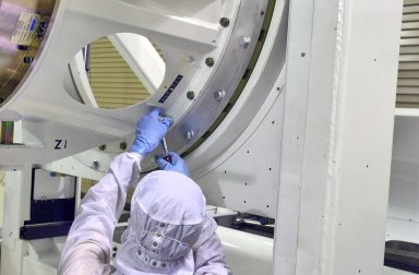 KENNEDY SPACE CENTER, FLA. - Inside the Astrotech Payload Processing Facility on Vandenberg Air Force Base in California, workers make adjustments on the tilt dolly before attempting to raise the Cloud-Aerosol Lidar and Infrared Pathfinder Satellite Observation (CALIPSO) spacecraft to vertical. CALIPSO will be moved to a workstand. It will undergo state-of-health checks, and electrical ground-support equipment testing. CALIPSO will fly in combination with the CloudSat satellite to provide never-before-seen 3-D perspectives of how clouds and aerosols form, evolve, and affect weather and climate. CALIPSO and CloudSat will join three other satellites in orbit to enhance understanding of climate systems. The launch date for CALIPSO/CloudSat is no earlier than Aug. 22.