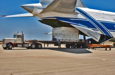 KENNEDY SPACE CENTER, FLA. - At Vandenberg Air Force Base in California, the Cloud-Aerosol Lidar and Infrared Pathfinder Satellite Observation (CALIPSO) spacecraft is offloaded from the Antonov aircraft that delivered it. It will be transported to the VAFB Astrotech Payload Processing Facility. CALIPSO will fly in combination with the CloudSat satellite to provide never-before-seen 3-D perspectives of how clouds and aerosols form, evolve, and affect weather and climate. CALIPSO and CloudSat will join three other satellites in orbit to enhance understanding of climate systems. The launch date for CALIPSO/CloudSat is no earlier than Aug. 22.