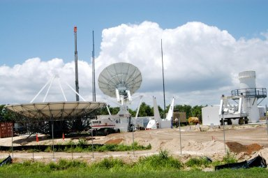 KENNEDY SPACE CENTER, FLA. - On June 13, the base for a C-band radar antenna (seen at left) can be seen under construction (at right) on a radar site on North Merritt Island, Fla. The 50-foot C-band radar will be used for long-term Shuttle missions to track the launches and observe possible debris coming from the Shuttle. In the background (center) is an existing 30-foot C-band Pathfinder radar whose use was demonstrated on the Delta Messenger launch. It will be used on the upcoming two Return to Flight missions. The launch window for the first Return to Flight mission, STS-114, is July 13 to July 31.