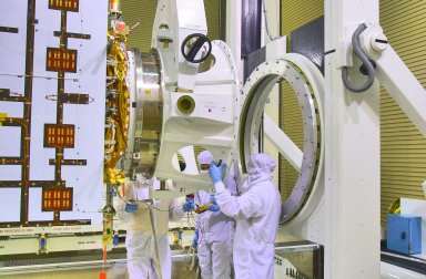 KENNEDY SPACE CENTER, FLA. - Inside the Astrotech Payload Processing Facility on Vandenberg Air Force Base in California, workers prepare to raise the Cloud-Aerosol Lidar and Infrared Pathfinder Satellite Observation (CALIPSO) spacecraft to vertical. CALIPSO will be moved to a workstand. It will undergo state-of-health checks, and electrical ground-support equipment testing. CALIPSO will fly in combination with the CloudSat satellite to provide never-before-seen 3-D perspectives of how clouds and aerosols form, evolve, and affect weather and climate. CALIPSO and CloudSat will join three other satellites in orbit to enhance understanding of climate systems. The launch date for CALIPSO/CloudSat is no earlier than Aug. 22.