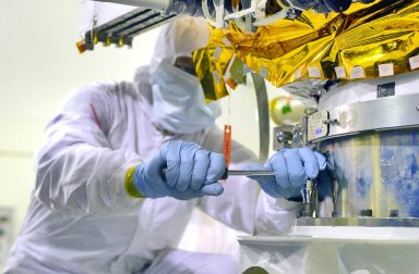 KENNEDY SPACE CENTER, FLA. -Inside the Astrotech Payload Processing Facility on Vandenberg Air Force Base in California, workers prepare the Cloud-Aerosol Lidar and Infrared Pathfinder Satellite Observation (CALIPSO) spacecraft to be lifted and transferred to a workstand. CALIPSO will undergo state-of-health checks, and electrical ground-support equipment testing. CALIPSO will fly in combination with the CloudSat satellite to provide never-before-seen 3-D perspectives of how clouds and aerosols form, evolve, and affect weather and climate. CALIPSO and CloudSat will join three other satellites in orbit to enhance understanding of climate systems. The launch date for CALIPSO/CloudSat is no earlier than Aug. 22.