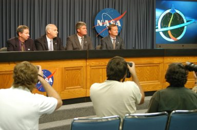 KENNEDY SPACE CENTER, FLA. - Space Shuttle managers take questions from the media during a press conference held following the conclusion of the Flight Readiness Review for Space Shuttle Discovery's Return to Flight mission STS-114. From left are NASA's Administrator Michael Griffin, Associate Administrator for Space Operations William Readdy, Space Shuttle Program Manager William Parsons, and Space Shuttle Launch Director Michael Leinbach. A July 13 launch date was approved for the 12-day mission during which Discovery?s seven-person crew will test new hardware and techniques to improve Shuttle safety, as well as deliver supplies to the International Space Station.