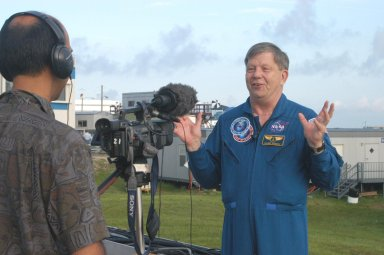 KENNEDY SPACE CENTER, FLA. - Roger Crouch, a payload specialist, talks to the media prior to the launch at 3:51 p.m. of Space Shuttle Discovery on the historic Return to Flight mission STS-114. He has flown on two Shuttle missions, STS-83 and STS-94. STS-114 is the 114th Space Shuttle flight and the 31st for Discovery. The 12-day mission is expected to end with touchdown at the Shuttle Landing Facility at 11:06 a.m. July 25.