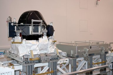 KENNEDY SPACE CENTER, FLA. - In the Space Station Processing Facility, the Control Moment Gyroscope (CMG) at left is being returned to the vendor for repair. The faulty CMG was removed from the International Space Station and replaced with a new one on mission STS-114 in August. A control moment gyroscope is an actuator used to apply very high attitude-control torques to agile spacecraft. The Space Station uses four massive control moment gyroscopes to maintain the Station?s orientation in space.