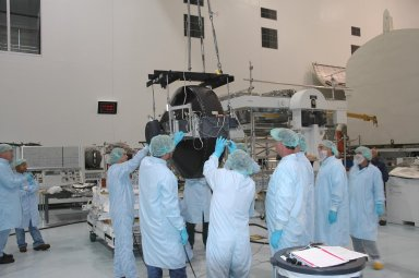 KENNEDY SPACE CENTER, FLA. - In the Space Station Processing Facility, the Control Moment Gyroscope (CMG) is separated from its base and workers help guide it toward a shipping container for its return to the vendor for repair. The faulty CMG was removed from the International Space Station and replaced with a new one on mission STS-114 in August. A control moment gyroscope is an actuator used to apply very high attitude-control torques to agile spacecraft. The Space Station uses four massive control moment gyroscopes to maintain the Station?s orientation in space.