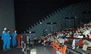 KENNEDY SPACE CENTER, FLA. - At a celebration for the STS-114 crew and the successful return to flight mission, members of the crew relate their experiences for an enthusiastic audience of employees and family members in the IMAX Theater. On the stage from left are Mission Specialists Soichi Noguchi and Charles Camarda, and Commander Eileen Collins at the podium. The crew returned to Florida especially for the celebration in the KSC Visitor Complex.
