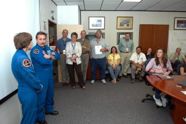 KENNEDY SPACE CENTER, FLA. - STS-114 Mission Specialists Wendy Lawrence (far left) speaks to Kennedy employees in the Space Station Processing Facility while Mission Specialist Charles Camarda (left) listens. They and the other crew members visited several sites during their return to the Center. Their return is being celebrated at a gathering at the KSC Visitor Complex later this evening.
