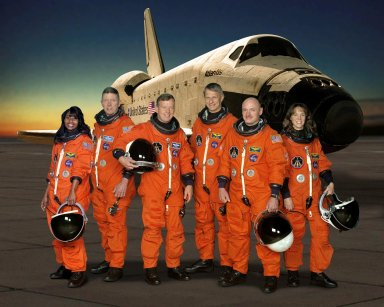 JOHNSON SPACE CENTER, TEXAS -- STS121-S-002 -- These six astronauts take a break from training to pose for the STS-121 crew portrait. From the left are astronauts Stephanie D. Wilson, Michael E. Fossum, both mission specialists; Steven W. Lindsey, commander; Piers J. Sellers, mission specialist; Mark E. Kelly, pilot; and Lisa M. Nowak, mission specialist. Photo Credit: NASA/JSC