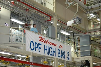 KENNEDY SPACE CENTER, FLA. - In NASA Kennedy Space Center?s Orbiter Processing Facility bay 3, a fuel cell removed from the orbiter Discovery is lowered toward the floor. Fuel cells are located under the forward portion of the payload bay. They make power for the orbiter by mixing hydrogen and oxygen to produce electricity. Fuel cells also create potable water that is pumped into storage tanks for the crew to use in orbit. Discovery is the designated orbiter for the second return-to-flight mission, STS-121, scheduled for launch in May. Photo credit: NASA/Kim Shiflett