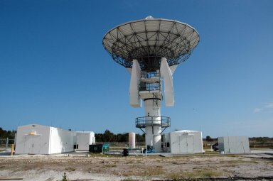 KENNEDY SPACE CENTER, FLA. - This new C-band, 3 megawatt radar with a 50-foot dish antenna has recently been installed on north Kennedy Space Center. It is one of the largest of its kind in the world, providing higher definition imagery than has ever been available before. Working in concert with two new NASA-owned X-band radars mounted on the solid rocket booster retrieval ships, tracking the space shuttle and expendable launch vehicles with this new capability will provide more detail than NASA has ever observed by radar before. The first use of this C-band radar will be for the launch of the Atlas V rocket sending the New Horizons probe toward Pluto. The radar is operated under a NASA contract with the U.S. Navy who owns the radar.