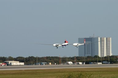 KENNEDY SPACE CENTER, FLA. - The Virgin Atlantic Airways GlobalFlyer aircraft approaches NASA Kennedy Space Center?s Shuttle Landing Facility for a landing. The aircraft, piloted by Steve Fossett, is being relocated from Salina, Kan., to the Shuttle Landing Facility to begin preparations for an attempt to set a new world record for the longest flight made by any aircraft. An exact takeoff date for the record-setting flight has not been determined and is contingent on weather and jet-stream conditions. The window for the attempt opens in mid-January, making the flight possible anytime between then and the end of February. NASA agreed to let Virgin Atlantic Airways use Kennedy's Shuttle Landing Facility as a takeoff site. The facility use is part of a pilot program to expand runway access for non-NASA activities.