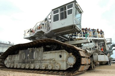 KENNEDY SPACE CENTER, FLA. - On the occasion of the 40th anniversary of the crawler transporter used for moving space shuttles to the NASA Kennedy Space Center?s launch pads, media get a rare opportunity to ride on and photograph one of the crawlers up close. Media representatives and invited guests had the opportunity to tour one of NASA's two crawlers. This included the driver cab and engine room. Guests included current drivers and operators, as well as drivers from the Apollo Program. In January 1966, the crawler completed its first successful move with a 10.6-million-pound launch umbilical tower. It moved three-quarters of a mile in about nine hours. Throughout 40 years of service, the two crawlers have moved more than 3,500 miles and carried seven vehicles.