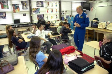 KENNEDY SPACE CENTER, FLA. ? At Warrington Middle School in Pensacola, Fla., astronaut Alan Poindexter talks to students. Poindexter joined Center Director Jim Kennedy on a visit to the school, which has been named one of NASA?s Explorer Schools (NES). Kennedy is visiting the school to share the vision for space exploration with the next generation. He is talking with students about our destiny as explorers, NASA?s stepping stone approach to exploring Earth, the moon, Mars and beyond, how space impacts our lives, and how people and machines rely on each other in space. NES establishes a three-year partnership annually between NASA and 50 NASA Explorer School teams, consisting of teachers and education administrators from diverse communities nationwide. Photo credit: NASA/Cory Huston