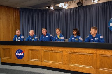 KENNEDY SPACE CENTER, FLA. - In the television studio at NASA Kennedy Space Center, the STS-121 crew answers questions during a media conference. Seated from left are Commander Steven Lindsey, Pilot Mark Kelly and Mission Specialists Michael Fossum, Lisa Nowak, Stephanie Wilson and Piers Sellers. The seventh crew member, Mission Specialist Thomas Reiter, did not attend. The crew is at NASA Kennedy Space Center for the crew equipment interface test, which provides hands-on experiences with equipment used on-orbit. The launch of STS-121, the second return-to-flight mission, is scheduled for May. Photo credit: NASA/Kim Shiflett