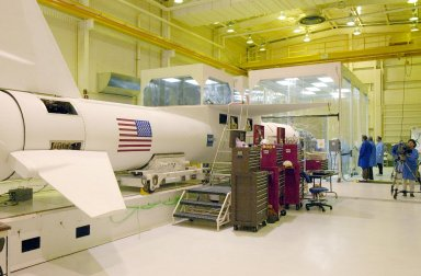 KENNEDY SPACE CENTER, FLA. - Inside Orbital Sciences? Building 1555 at Vandenberg Air Force Base in California, the Pegasus XL launch vehicle is complete after mating with the Space Technology 5 (ST5). The ST5 contains three microsatellites, with miniaturized redundant components and technologies. Each will validate New Millennium Program selected technologies, such as the Cold Gas Micro-Thruster and X-Band Transponder Communication System. After deployment from the Pegasus, the micro-satellites will be positioned in a ?string of pearls? constellation that demonstrates the ability to position them to perform simultaneous multi-point measurements of the magnetic field using highly sensitive magnetometers. The data will help scientists understand and map the intensity and direction of the Earth?s magnetic field, its relation to space weather events, and affects on our planet. With such missions, NASA hopes to improve scientists? ability to accurately forecast space weather and minimize its harmful effects on space- and ground-based systems. Launch of ST5 is scheduled no earlier than March 6 from Vandenberg Air Force Base.