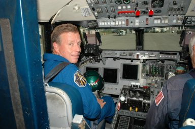KENNEDY SPACE CENTER, FLA. - At the Shuttle Landing Facility, STS-121 Commander Steven Lindsey gets ready for a training flight in a Shuttle Training Aircraft (STA). He will be practicing landing the orbiter using the STA, which is a modified Grumman American Aviation-built Gulf Stream II jet that was modified to simulate an orbiter?s cockpit, motion and visual cues, and handling qualities. In flight, the STA duplicates the orbiter?s atmospheric descent trajectory from approximately 35,000 feet altitude to landing on a runway. Because the orbiter is unpowered during re-entry and landing, its high-speed glide must be perfectly executed the first time. Space Shuttle Discovery is scheduled to launch July 1 on mission STS-121. Photo credit: NASA/Kim Shiflett