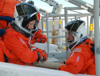 KENNEDY SPACE CENTER, FLA. - STS-121 Commander Steven Lindsey (left) and Pilot Mark Kelly take part in emergency egress practice, part of the Terminal Countdown Demonstration Test (TCDT) activities that include a simulated countdown culminating in main engine cutoff. Mission STS-121 is scheduled to be launched July 1. Photo credit: NASA/Kim Shiflett