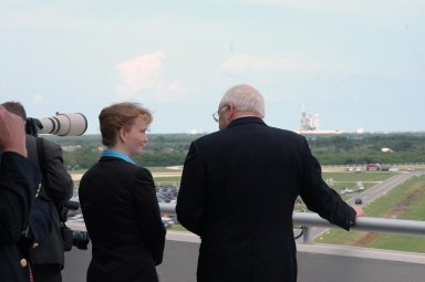 KENNEDY SPACE CENTER, FLA. - From the viewing area of the Operations and Support Building II, U.S. Vice President Dick Cheney has a direct view to Launch Pad 39B and Space Shuttle Discovery. Cheney flew in to view the launch of Discovery on mission STS-121. Standing next to him is Shana Dale, NASA deputy administrator. Photo credit: NASA/Kim Shiflett