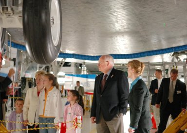 KENNEDY SPACE CENTER, FLA. - In the Orbiter Processing Facility, U.S. Vice President Dick Cheney (second from right) and family get a close look at the orbiter Atlantis on a personal tour guided by Scott Thurston, Crew Exploration Vehicle manager in the Shuttle Processing Directorate. Thurston previously was the NASA flow director for Atlantis. To the right of Cheney is Shana Dale, NASA deputy administrator. Cheney flew in to view the launch of Space Shuttle Discovery on mission STS-121. Photo credit: NASA/Kim Shiflett