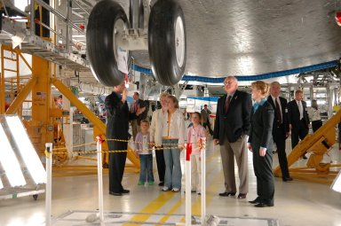KENNEDY SPACE CENTER, FLA. - Standing underneath the orbiter Atlantis in the Orbiter Processing Facility, Scott Thurston (far left) Crew Exploration Vehicle manager in the Shuttle Processing Directorate, gives a personal tour to U.S. Vice President Dick Cheney (second from right) and his family. Thurston previously was the NASA flow director for Atlantis. To the right of Cheney is Shana Dale, NASA deputy administrator. Cheney flew in to view the launch of Space Shuttle Discovery on mission STS-121. Photo credit: NASA/Kim Shiflett