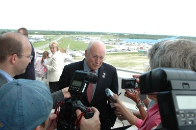 KENNEDY SPACE CENTER, FLA. - U.S. Vice President Dick Cheney talks to the media on the observation deck of the Operations and Support Building II at NASA's Kennedy Space Center. In the background, the white jacket, is Cheney's wife, Lynne. Cheney is at the Center to view the launch of Space Shuttle Discovery on mission STS-121. Photo credit: NASA/Kim Shiflett