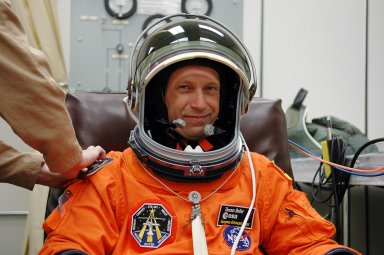 KENNEDY SPACE CENTER, FLA. - Prior to the third launch attempt on mission STS-121, Mission Specialist Thomas Reiter is suiting up before heading to Launch Pad 39B. The July 2 launch attempt was scrubbed due to the presence of showers and thunderstorms within the surrounding area of the launch site. The launch of Space Shuttle Discovery on mission STS-121 is the 115th shuttle flight and the 18th U.S. flight to the International Space Station. During the 12-day mission, the STS-121 crew will test new equipment and procedures to improve shuttle safety, as well as deliver supplies and make repairs to the International Space Station. Photo credit: NASA/Kim Shiflett