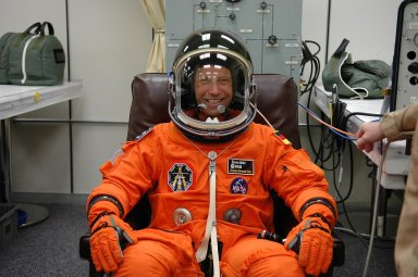 KENNEDY SPACE CENTER, FLA. - Mission Specialist Thomas Reiter, happy to be making a third launch attempt on mission STS-121, is suited up before heading to Launch Pad 39B. The July 2 launch attempt was scrubbed due to the presence of showers and thunderstorms within the surrounding area of the launch site. The launch of Space Shuttle Discovery on mission STS-121 is the 115th shuttle flight and the 18th U.S. flight to the International Space Station. During the 12-day mission, the STS-121 crew will test new equipment and procedures to improve shuttle safety, as well as deliver supplies and make repairs to the International Space Station. Photo credit: NASA/Kim Shiflett