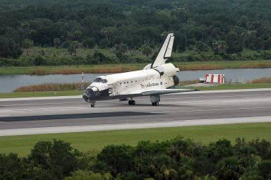 KENNEDY SPACE CENTER, FLA. - The orbiter Discovery slows to a stop after landing on Runway 15 at NASA's Shuttle Landing Facility, completing mission STS-121 to the International Space Station. Discovery traveled 5.3 million miles, landing on orbit 202. Mission elapsed time was 12 days, 18 hours, 37 minutes and 54 seconds. Main gear touchdown occurred on time at 9:14:43 EDT. Wheel stop was at 9:15:49 EDT. The returning crew members aboard are Commander Steven Lindsey, Pilot Mark Kelly and Mission Specialists Piers Sellers, Michael Fossum, Lisa Nowak and Stephanie Wilson. Mission Specialist Thomas Reiter, who launched with the crew on July 4, remained on the station to join the Expedition 13 crew there. The landing is the 62nd at Kennedy Space Center and the 32nd for Discovery. Discovery's landing was as exhilarating as its launch, the first to take place on America's Independence Day. During the mission, the STS-121 crew tested new equipment and procedures to improve shuttle safety, and delivered supplies and made repairs to the International Space Station. Photo credit: NASA/Kim Shiflett