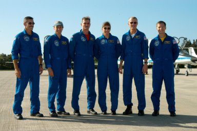 KENNEDY SPACE CENTER, FLA. - After their arrival at KSC's Shuttle Landing Facility, the STS-115 crew poses for a photo after talking to the media. From left are Mission Specialists Daniel Burbank, Steven MacLean, Joseph Tanner and Heidemarie Stefanyshyn-Piper; Commander Brent Jett; and Pilot Christopher Ferguson. The STS-115 crew has flown to NASA's Kennedy Space Center to take part in Terminal Countdown Demonstration Test activities. The TCDT is a pre-launch preparation that includes practicing emergency egress from the pad, driving an M-113 armored personnel carrier, and simulating the launch countdown. Launch of STS-115 is currently scheduled for Aug. 27. Photo credit: NASA/George Shelton