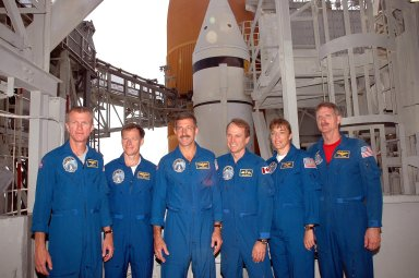 KENNEDY SPACE CENTER, FLA. - The STS-115 crew pauses for a photo during training on Launch Pad 39B. From left are Mission Commander Brent Jett, Pilot Chris Ferguson, and Mission Specialists Daniel Burbank, Steven MacLean, Heidemarie Stefanyshyn-Piper and Joseph Tanner. The mission crew is at KSC for Terminal Countdown Demonstration Test (TCDT) activities that are preparation for launch on Space Shuttle Atlantis, scheduled to take place in a window that opens Aug. 27. During their 11-day mission to the International Space Station, the STS-115 crew will continue construction of the station and attach the payload elements, the Port 3/4 truss segment with its two large solar arrays. Photo credit: NASA/Cory Huston