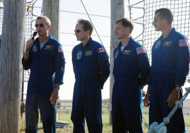 KENNEDY SPACE CENTER, FLA. - The STS-115 crew responds to questions from the media at a press conference held on Launch Pad 39B. Seen left to right are Commander Brent Jett, Mission Specialist Steven MacLean, Pilot Chris Ferguson, and Mission Specialist Daniel Burbank. Crew members not seen are Mission Specialists Heidemarie Stefanyshyn-Piper and Joseph Tanner. MacLean is with the Canadian Space Agency. The mission crew is at KSC for Terminal Countdown Demonstration Test activities that are preparation for launch on Space Shuttle Atlantis, scheduled to take place in a window that opens Aug. 27. The TCDT culminates in a simulated launch countdown. During their 11-day mission to the International Space Station, the STS-115 crew will continue construction of the station and attach the payload elements, the Port 3/4 truss segment with its two large solar arrays. Photo credit: NASA/Cory Huston