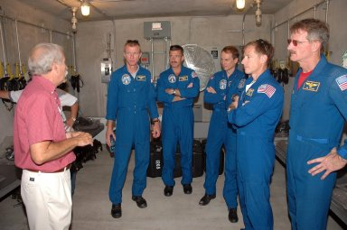 KENNEDY SPACE CENTER, FLA. - The STS-115 crew learn about use of the bunker in the event of an emergency at the launch pad. Seen in the photo are, from left, Commander Brent Jett, Mission Specialists Daniel Burbank and Steven MacLean, Pilot Chris Ferguson and Mission Specialist Joseph Tanner. Not pictured is Mission Specialist Heidemarie Stefanyshyn-Piper. The mission crew is at KSC for Terminal Countdown Demonstration Test (TCDT) activities that are preparation for launch on Space Shuttle Atlantis, scheduled to take place in a window that opens Aug. 27. During their 11-day mission to the International Space Station, the STS-115 crew will continue construction of the station and attach the payload elements, the Port 3/4 truss segment with its two large solar arrays. Photo credit: NASA/Cory Huston