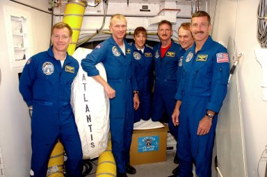 KENNEDY SPACE CENTER, FLA. - The STS-115 crew is in the White Room on the orbiter access arm on Launch Pad 39B to get instruction on using the emergency egress system. From left are Pilot Chris Ferguson, Commander Brent Jett, and Mission Specialists Heidemarie Stefanyshyn-Piper, Joseph Tanner, Steven MacLean and Daniel Burbank. MacLean is with the Canadian Space Agency. The White Room provides access into the orbiter through the crew access hatch. The mission crew is at KSC for Terminal Countdown Demonstration Test (TCDT) activities that are preparation for launch on Space Shuttle Atlantis, scheduled to take place in a window that opens Aug. 27. During their 11-day mission to the International Space Station, the STS-115 crew will continue construction of the station and attach the payload elements, the Port 3/4 truss segment with its two large solar arrays. Photo credit: NASA/Cory Huston