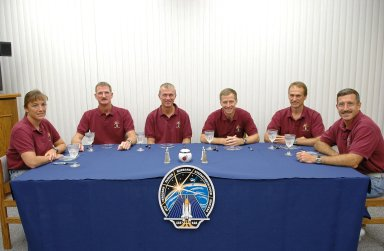 KENNEDY SPACE CENTER, FLA. - After a week's delay of launching due to weather and technical issues, the crew of mission STS-115 have had the traditional breakfast before their third attempt to launch on Space Shuttle Atlantis. Seated left to right are Mission Specialists Heidemarie Stefanyshyn-Piper and Joseph Tanner, Commander Brent Jett, Pilot Christopher Ferguson and Mission Specialists Steven MacLean and Daniel Burbank. MacLean is with the Canadian Space Agency. The launch attempt on Sept. 8 was scrubbed due to an issue with a fuel cut-off sensor system inside the external fuel tank. This is one of several systems that protect the shuttle's main engines by triggering their shutdown if fuel runs unexpectedly low. Following the breakfast, the crew will don their launch suits before heading to Launch Pad 39B. During the STS-115 mission, Atlantis' astronauts will deliver and install the 17.5-ton, bus-sized P3/P4 integrated truss segment on the station. The girder-like truss includes a set of giant solar arrays, batteries and associated electronics and will provide one-fourth of the total power-generation capability for the completed station. This mission is the 116th space shuttle flight, the 27th flight for orbiter Atlantis, and the 19th U.S. flight to the ISS. STS-115 is scheduled to last 11 days with a planned landing at KSC. Photo credit: NASA/Kim Shiflett