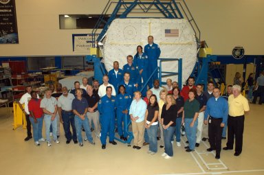 KENNEDY SPACE CENTER, FLA. - At SPACEHAB in Cape Canaveral, Fla., the STS-116 crew poses with the workers during a familiarization period. On the stairs, bottom to top, are Pilot William Oefelein, Mission Specialists Joan Higginbotham, Nicholas Patrick, Robert Curbeam, Christer Fuglesang and Sunita Williams, and Commander Mark Polansky. The Swedish Fuglesang represents the European Space Agency. Mission crews make frequent trips to the Space Coast to become familiar with the equipment and payloads they will be using. STS-116 will be mission number 20 to the International Space Station and construction flight 12A.1. The mission payload is the SPACEHAB module, the P5 integrated truss structure and other key components. Launch is scheduled for no earlier than Dec. 7. Photo credit: NASA/George Shelton