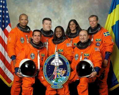 KENNEDY SPACE CENTER, FLA. - STS116-S-002 (21 July 2006) --- These seven astronauts take a break from training to pose for the STS-116 crew portrait. Scheduled to launch aboard the Space Shuttle Discovery are, front row (from the left), astronauts William A. Oefelein, pilot; Joan E. Higginbotham, mission specialist; and Mark L. Polansky, commander. On the back row (from the left) are astronauts Robert L. Curbeam, Nicholas J.M. Patrick, Sunita L. Williams and the European Space Agency's Christer Fuglesang, all mission specialists. Williams will join Expedition 14 in progress to serve as a flight engineer aboard the International Space Station. The crewmembers are attired in training versions of their shuttle launch and entry suits.